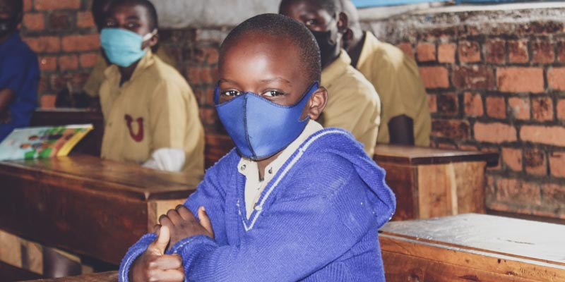 A student in class at Kirerema Primary School