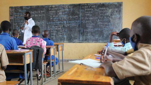 Teacher at Kabirizi instructing students